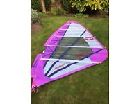 Windsurfing sails and gear includes 5 sails, a windsurfer 2 masts and 2 booms. Will separate