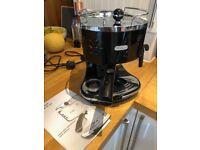 DeLonghi coffee maker with milk steamer