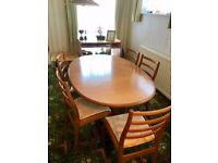 Wooden teak dining table and 6 chairs