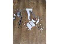 Nintendo Wii with 3 controllers, 2 nunchucks, all leads and charging port