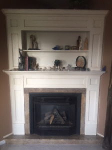 Wood mantel accented with marble for use in corner or flat wall