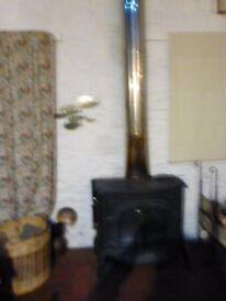 Vermont Defiant wood burner 1975 fair condition plus chimney diam. 210 ht. 3830