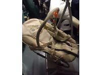 Hauck Bungee Deluxe rocker baby seat with carry handles and hanging figures