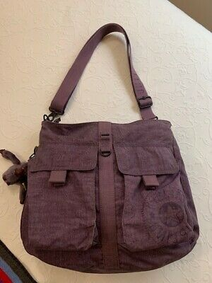 Kipling  never used zip with snap pockets cross body purse