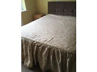Cream with beige floral pattern double bed Bedspread £15 B15 or B7 (has matching curtains)