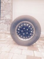 4- Motomaster studded snow tirea on rims with wheel covers
