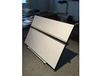 A used adjustable drawing board. In very good condition.