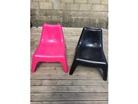 1 pink and 1 black ikea chair