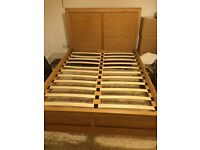 Feather and Black Double Wooden Bed Frame, good condition, second hand.