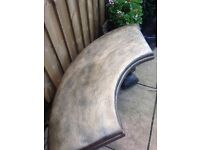Stunning solid stone crescent bench with squirrel feet