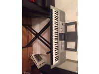 Electric Yamaha Piano (PSR E323), hardly used. Including stand.