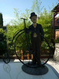 Charlie Chaplin holding Penny Farthing