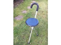 Folding stool with umbrella style carry handle.
