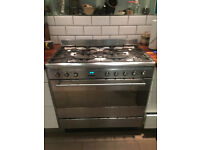 Smeg range oven cooker duel fuel with Rangemaster extractor and stainless steel splashback