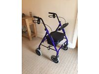 Lightweight Rollator mobility aid by Days Patterson with padded seat and shopping bag