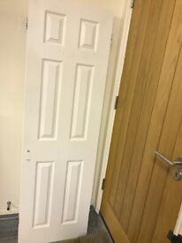 White interior door with hinges includes free door handle