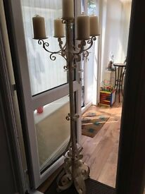 wrought iron candle stand with candles