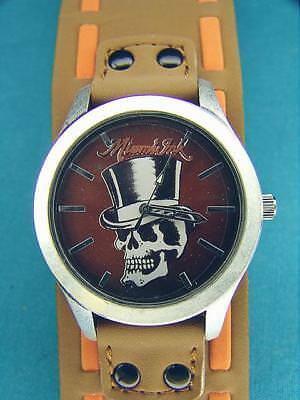 - NEW MIAMI INK SKULL WITH TOP HAT WATCH WRISTWATCH  BROWN BAND WITH ORANGE