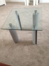 """Glass top coffee table on sturdy and stylish silver legs. 26"""" square (66cm) and 21"""" high (53cm)."""
