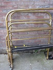 Antique brass single beds.