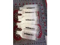FREE - traveling with wine? 'WINESKINS' - bottle protector sleeves
