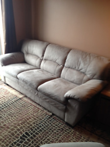 Pristine Sofa and Ottoman like new taupe.  Originally $1223