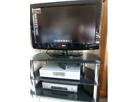 """TV 32"""" LG with a matching stand"""