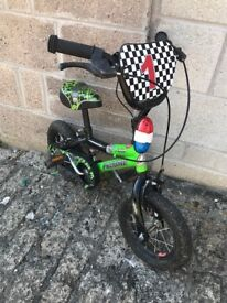 infants pedal bike / dinosaur themed with cool graphics