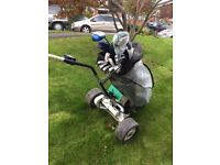 Powakaddy Electric Golf Trolley, charger, rain cover,clubs, & 20 golf balls