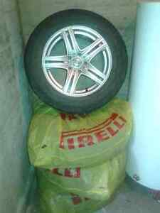 4 MAGS (RIMS) & TIRES 215/65R16  USED