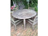 Teak circular Marston and Langinger table plus set of 4 Gloster teak chairs