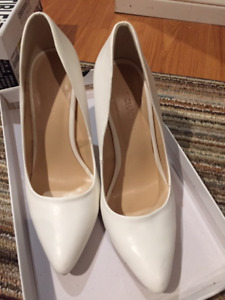New size 6 white high heels from La Chateau