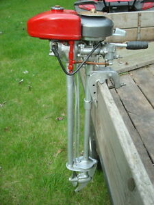 Vintage neptune outboard boat motor model 15b1 muncie gear for How does an outboard motor work