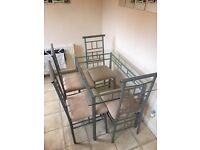Glass dining table with 4 chairs £85