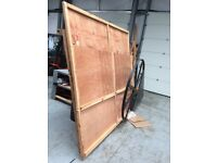 A selection of reclaimed plywood panels from large packing cases