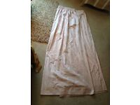 A pair of full length lined pencil pleat headed curtains, with a roll of matching wallpaper
