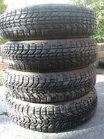 Selling four 215/60/16 winter tires and rims