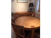 Solid oak round table, 4 dining chairs and sideboard