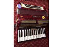 80 bass Worldmaster piano accordian, good playing but a bit scruffy, with case.