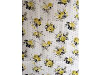 Roman blind in grey and lemon floral fabric