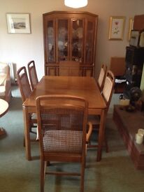 Dining room table with set of chairs and matching display cabinet