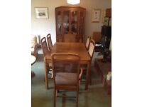 Expandable dining room table with set of chairs and matching display cabinet