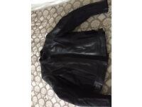 Man's leather motorbike jacket.