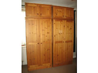 A Pair of Pine Wardrobes with Matching Top Boxes