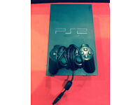 PLAYSTATION 2 ORIGINAL WITH 12 MONTH WARRANTY.