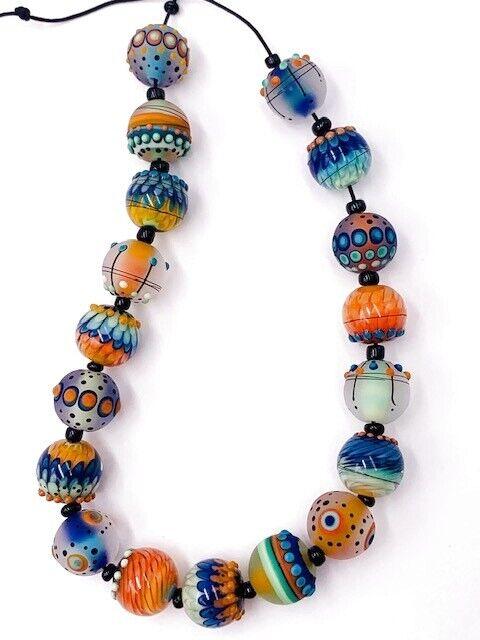 MAGMA HANDMADE ROUND GLASS LAMPWORK BLUE ORANGE YELLOW BEADS REGIS TEIXERA