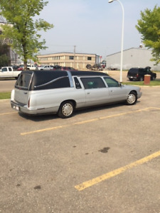 1999 Cadillac Hearse (Silver with black hard top)