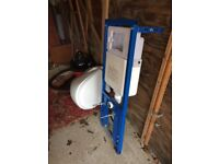 Wall hung german toilet including hidden cistern and soft close seat and lid