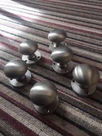 Three pairs of chrome satin door knobs