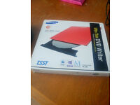 Samsung Ultra Thin DVD Writer in red. Unwanted gift in excellent condition!